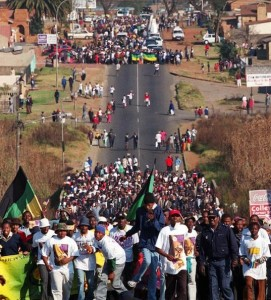 People march in Soweto, South Africa Saturday, June 16, 2001, to commemorate the 25th anniversary of the Soweto uprising. (AP Photo)